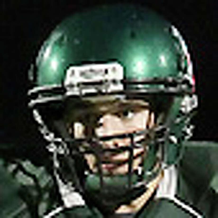 Reagan quarterback Trevor Knight (10) evades Alamo Heights' Garret Hisle (84) in football at Comalander Stadium on Friday, Sept. 17, 2010. Kin Man Hui/kmhui@express-news.net / kmhui@express-news.net