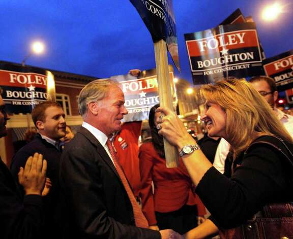 Connecticut Republican gubernatorial candidate Tom Foley greets supporters outside the Warner Theater in downtown Torrington, Conn. before a debate against Democratic candidate Dan Malloy on Monday, Oct. 25, 2010. (AP Photo/Christopher Massa, Pool) Photo: Christopher Massa, AP / Christopher Massa