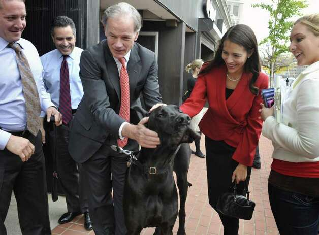 Republican candidate for governor Tom Foley and his wife Leslie pet a Great Dane belonging to Andrew Goldsteind during a tour of businesses in Waterbury, Conn., Monday, Oct. 25, 2010.  (AP Photo/Jessica Hill) Photo: Jessica Hill, AP / AP2010