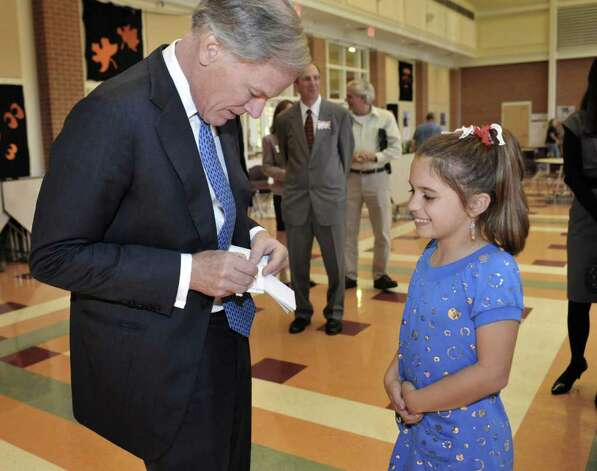 Republican candidate for governor Tom Foley, left, gives an autograph to 4th grade student Maddie McGee during a visit to a Frenchtown Elementary School for Democracy Day in Trumbull, Conn., Tuesday, Oct. 26, 2010.  (AP Photo/Jessica Hill) Photo: Jessica Hill, AP / AP2010