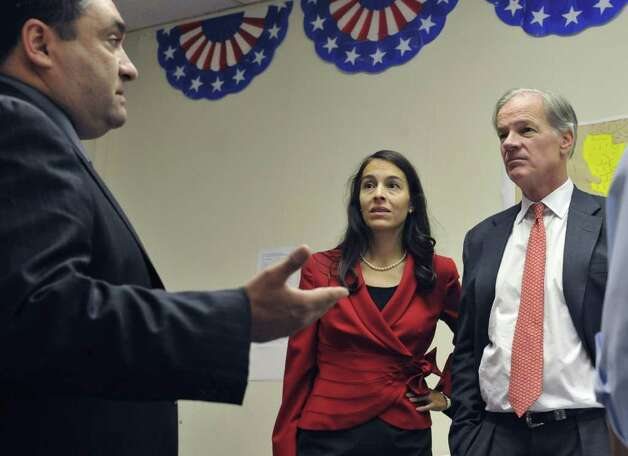 Republican candidate for governor Tom Foley, right, and his wife Leslie, center, listen to local candidate for State Rep. of the 75th district, Paul Nogueira, left, during a tour of businesses in Waterbury, Conn., Monday, Oct. 25, 2010.  (AP Photo/Jessica Hill) Photo: Jessica Hill, AP / AP2010