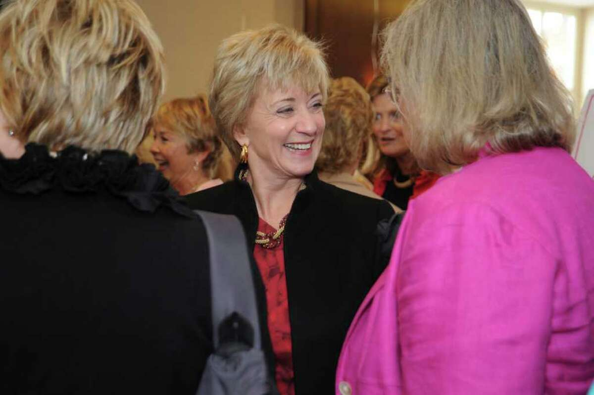 Linda McMahon, center, Republican candidate for U.S. senator, at the Breast Cancer Alliance's benefit luncheon and fashion show at the Hyatt Regency Greenwich, on Thursday, Oct. 28, 2010