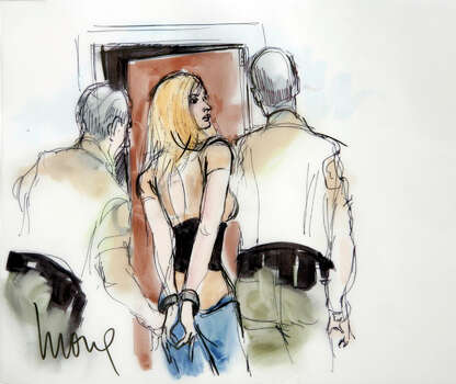 In a courtroom sketch drawn by Mona Shafer Edwards, actress Lindsay Lohan is shown in handcuffs as she is taken into custody at court in Beverly Hills, Calif. AP Photo/Mona Shafer Edwards / AP