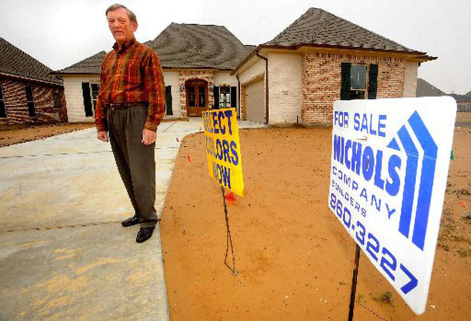 Howard Nichols of the Nichols Company Builders poses for a portrait in front of a home under construction Thursday in Beaumont. Tammy McKinley/ The Enterprise