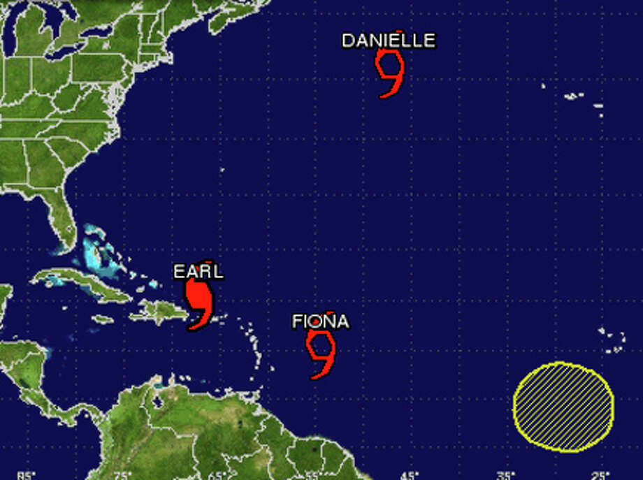 Tropical Storm Fiona follows in the wake of Hurricane Earl, which is following a similar path to now-Tropical Storm Danielle. Another area of low pressure follows Fiona. Graphic from the National Hurricane Center