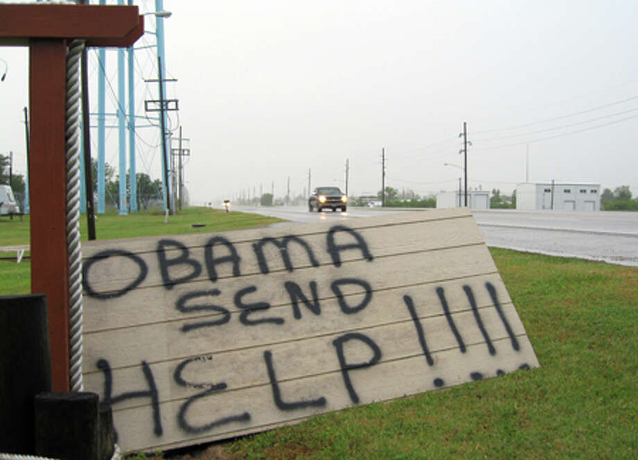 """A sign on the side of a road in Boothville, La., is shown Sunday. With no remedy in sight, President Barack Obama on Sunday warned of a """"massive and potentially unprecedented environmental disaster"""" as a badly damaged oil well in the Gulf of Mexico spewed a widening and deadly slick toward delicate wetlands and wildlife. He said it could take many days to stop. AP Photo/Allen Breed / AP"""