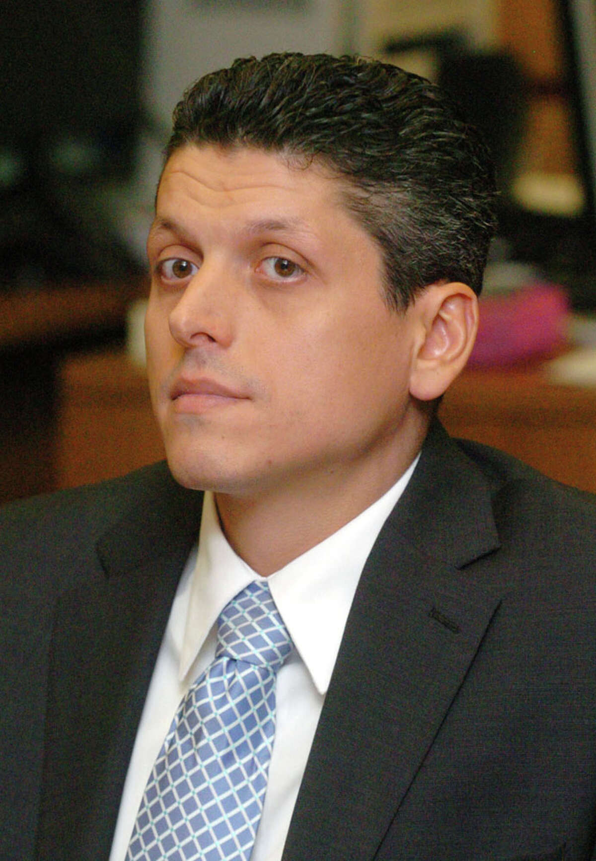 Marash Gojcaj listens to courtroom proceedings at the Superior Court in Danbury Sept., 15, 2010.