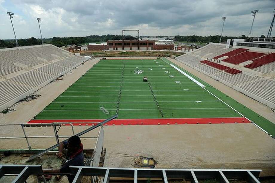 With the game one deadline nearing, Lamar laid turf on the the new football field Monday. Guiseppe Barranco/The Enterprise / Beaumont