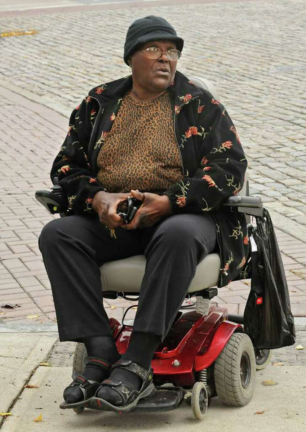 Bessie E. Thompson, who lives up on Morton Avenue (in background) talks about the reasons for getting bus service on Morton Avenue in Albany. Bessie has to ride her wheelchair in the street because of the lack of ramps in the sidewalks along Morton Avenue. (Lori Van Buren / Times Union)