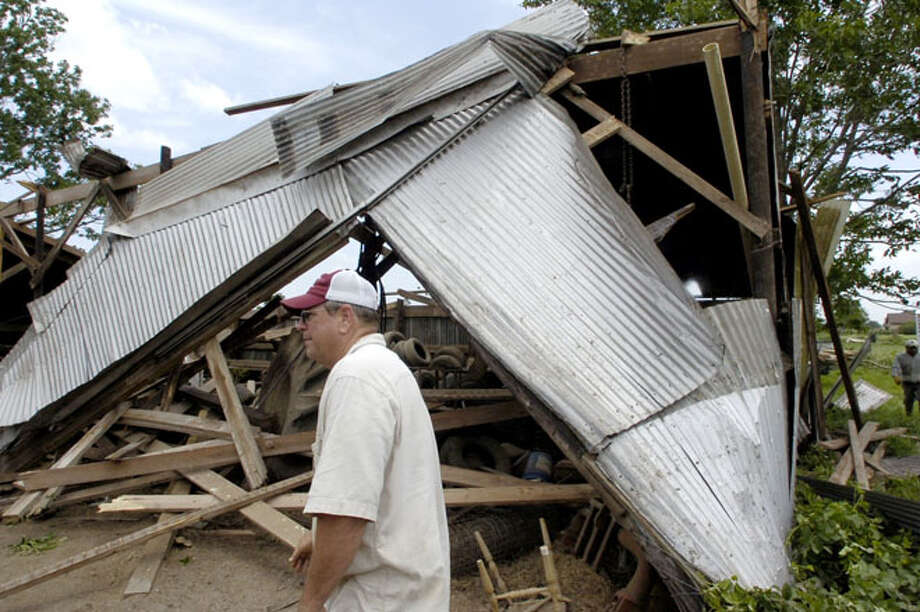 Roger Tindall,  part owner of Tindall and Moore Farms in Nome, lost a barn around 5:30 a.m. Wednesday morning when the area was hit by a suspected tornado.  The barn had seven horses in it at the time, who were ok when found, along with farm equipment which had some minor damage.   Dave Ryan/The Enterprise / Beaumont