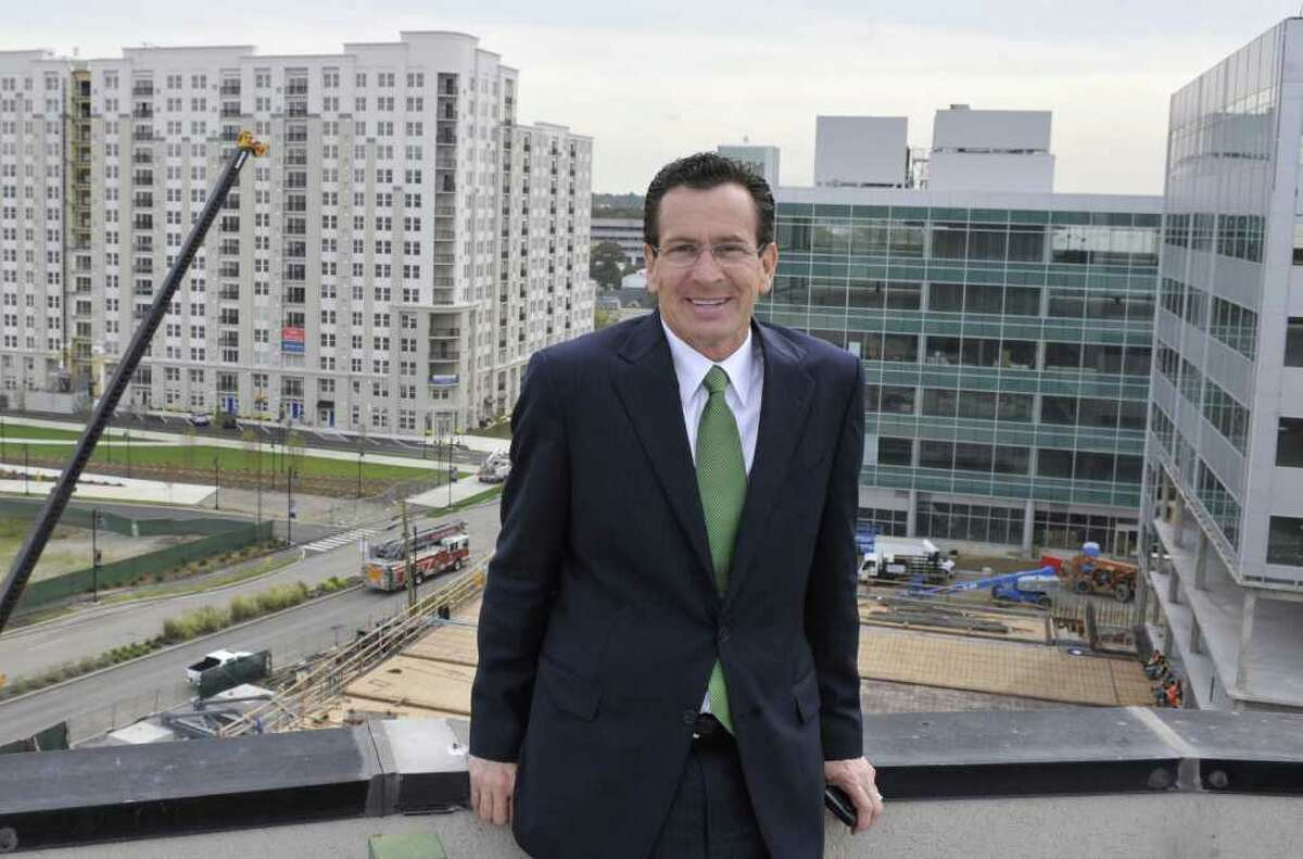 In this Oct. 20, 2010 photo, Democratic candidate for governor and former Stamford Mayor Dan Malloy poses for a photograph in an area of redevelopment in the south end of the city of Stamford, Conn. Malloy said the problems he faced as mayor, when the city was changing from a declining mill town to a financial center, are similar to the ones facing the state now, and he will apply his lessons learned if elected governor. (AP Photo/Jessica Hill)