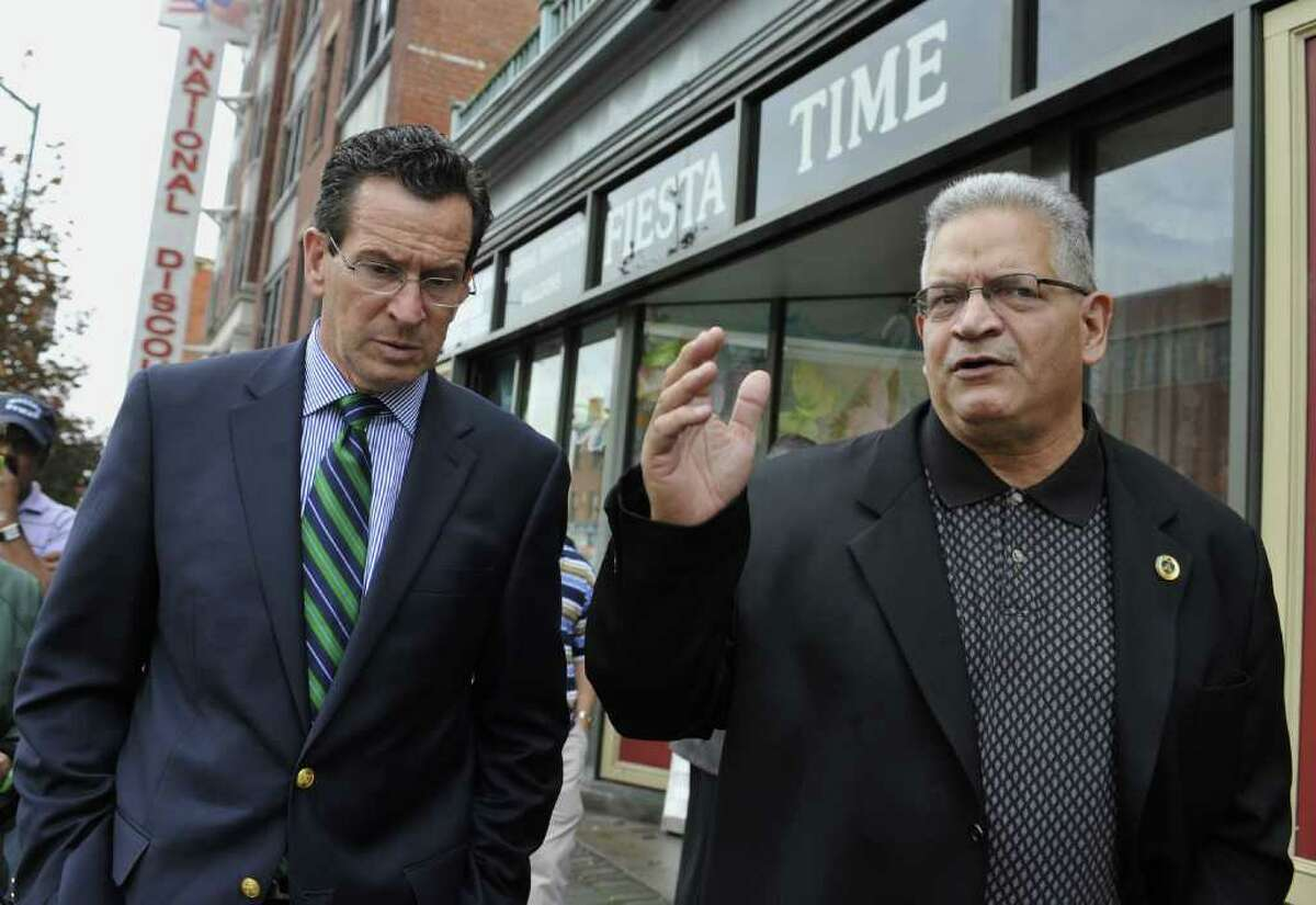 Connecticut Democratic gubernatorial candidate and former Stamford Mayor Dan Malloy, left, talks with Frank Alvarado of the Spanish American Merchants Association, during a tour of the Parkville section of Hartford, Conn., Wednesday, Oct. 27, 2010. Malloy faces Republican Tom Foley in the Nov. 2 election. (AP Photo/Jessica Hill)