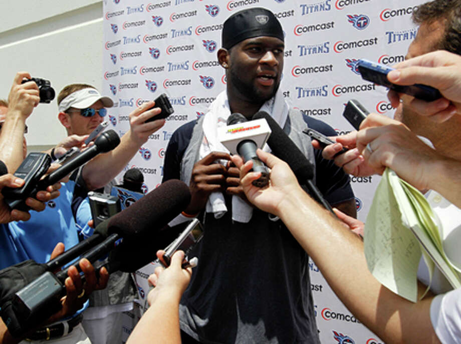 Former University of Texas quarterback and Tennessee Titans quarterback Vince Young answers questions after an NFL football minicamp workout on Monday in Nashville, Tenn. Young was involved in a fight in a Dallas strip club Sunday. AP Photo/Mark Humphrey / AP