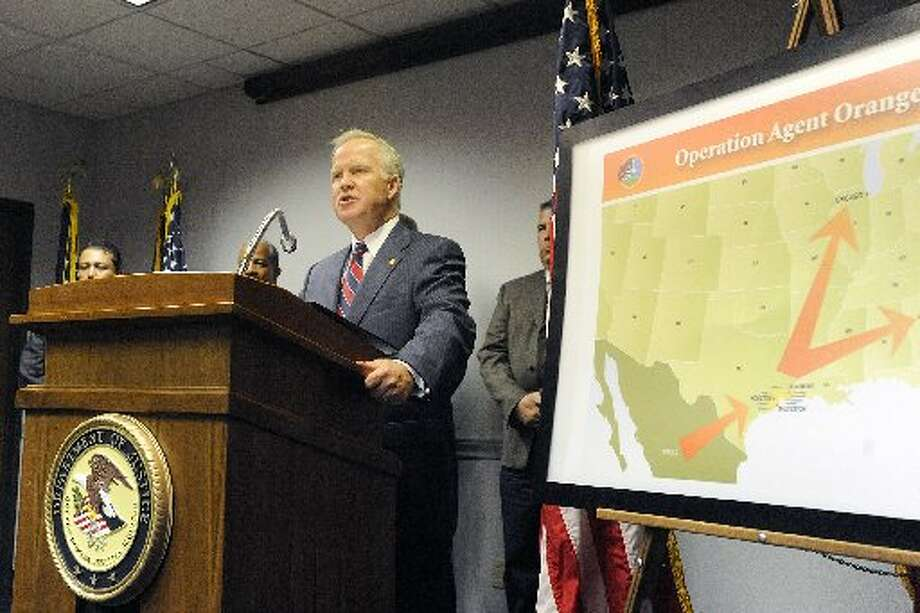 "U. S. Attorney Malcolm Bales, center, announced at a press conference in Beaumont, that federal, state and local agencies partnered together in an effort called, ""Operation Agent Orange, "" to take out an American drug organization that had direct ties to a major Mexican drug cartel. Valentino Mauricio/The Enterprise"