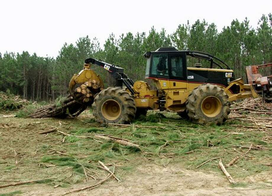 A $250,000 logging skidder, like this one pictured, was stolen this week in Jasper County. About $1 billion in heavy equipment is stolen every year according to he National Crime Insurance Crime Bureau. (AP Photo/Elliott Minor) / 2003 AP