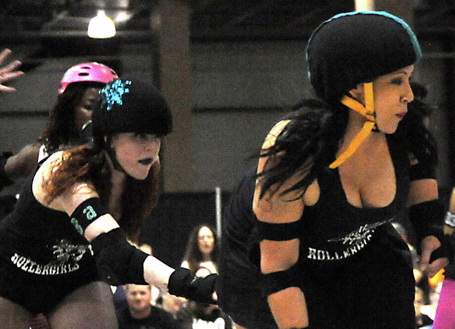 The Spindletop Roller Girls take on the Acadiana Good Times Rollers during the Spindletop Roller Girls first bout of the first season at Ford Exhibit Hall in Beaumont, Sunday. Tammy McKinley/ The Enterprise / Beaumont