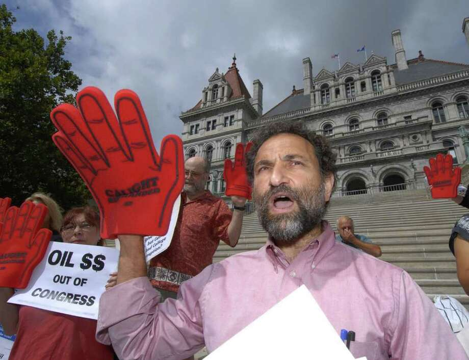 MoveOn organizer Joe Seeman says events targeting GOP House candidate Chris Gibson is to draw attention to what he calls the ?obscene? amount of money channeled into elections by oil and insurance companies. He is shown in this Times Union archive photo opposing the reelection of  former Rep. John Sweeney, a Republican,  in 2006. (Times Union archive) Photo: SKIP DICKSTEIN / ALBANY TIMES UNION