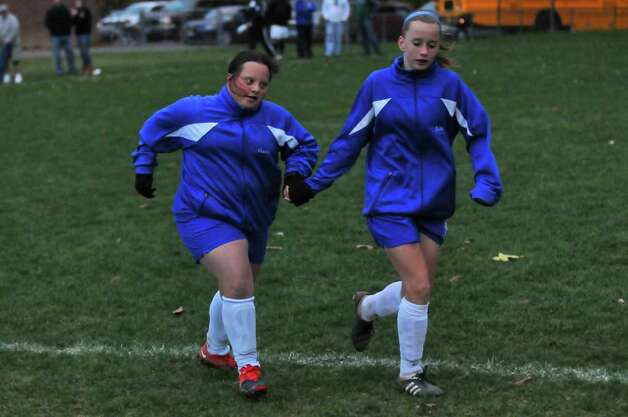 Shaker High School freshman Gianna MacPhee, left, jogs with teammate Meghan Kelly, right, Thursday, after their 1-0 loss to Shenendehowa in Latham. ( Philip Kamrass / Times Union ) Photo: Philip Kamrass