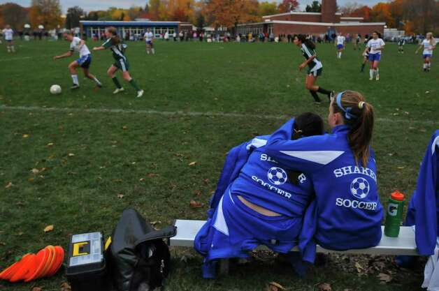 Shaker High School freshman Gianna MacPhee, right, and  teammate Meghan Kelly, try to stay warm Thursday in Latham during  their 1-0 loss to Shenendehowa, which ended their undefeated season. ( Philip Kamrass / Times Union ) Photo: Philip Kamrass