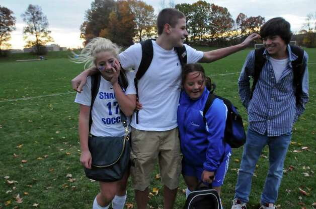 Shaker High School freshman Gianna MacPhee, second from right, greets her friends Kate Essepian, left, Michael Mainella, second from left, and Mike Sposito after  their 1-0 loss to Shenendehowa on Thursday in Latham. (Philip Kamrass / Times Union ) Photo: Philip Kamrass