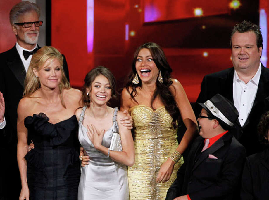 """The cast of """"Modern Family"""" react as they accepts the award for outstanding comedy series during the 62nd Primetime Emmy Awards Sunday, Aug. 29, 2010, in Los Angeles. From left are presenter Ted Danson, Julie Bowen, Sarah Hyland, Sofia Vergara, Rico Rodriguez and Eric Stonestreet.  (AP Photo/Chris Carlson) / AP"""
