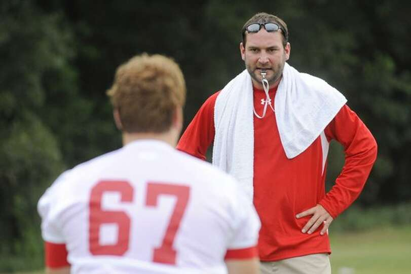 Lamar offensive line coach Nathan Reeves, center, watches the footwork of a Cardinal offensive linem