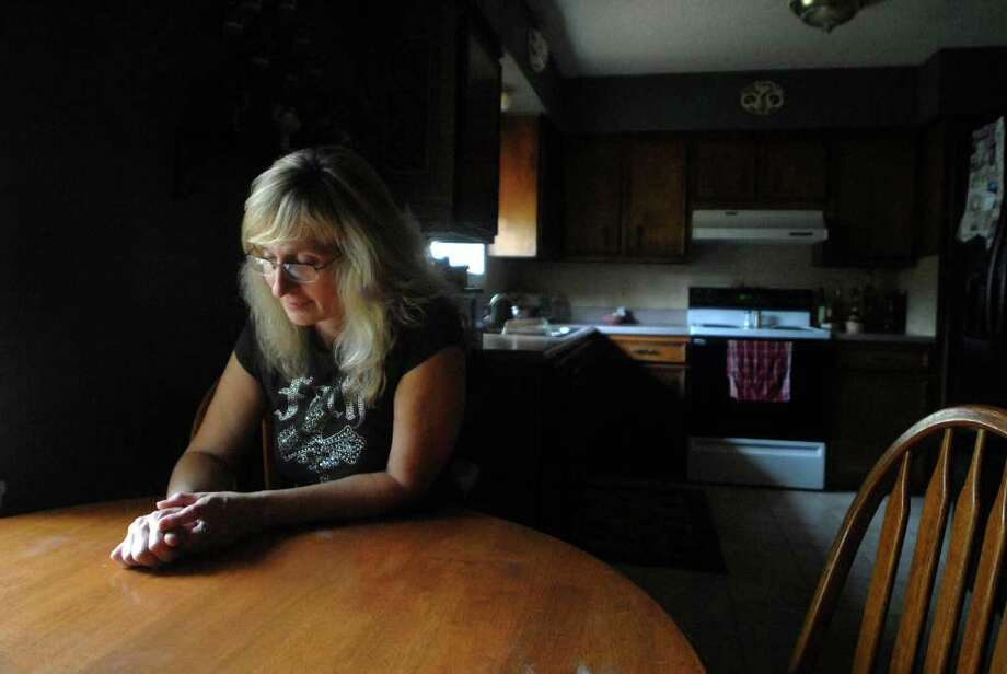 Suzette Ratcliff sits at her kitchen table at her Vidor home. Next month will be the one year anniversary of her daughter Rachel's death. Beth Rankin/The Enterprise