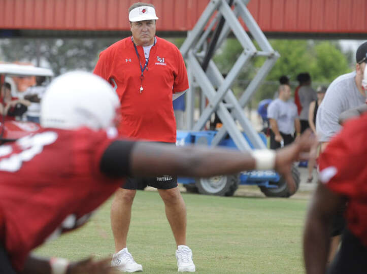 Lamar head football coach Ray Woodard, center, watches as his team works out Aug. 5. Valentino Mauri