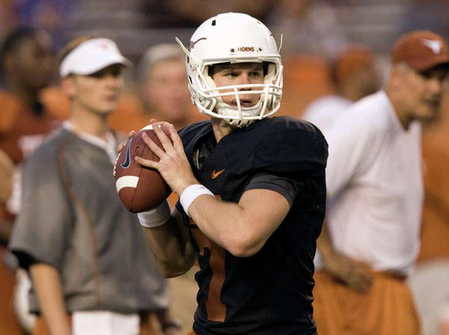 University of Texas quarterback Garrett Gilbert practices in Austin. AP Photo/American Statesman, Jay Janner / AMERICAN STATESMAN
