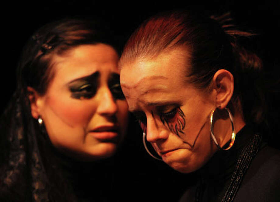 """Jackie Gower, left, and Dee Dee Howell argue the importance of king versus gods in Lamar University's production of """"Antigone."""" Guiseppe Barranco/The Enterprise / Beaumont"""