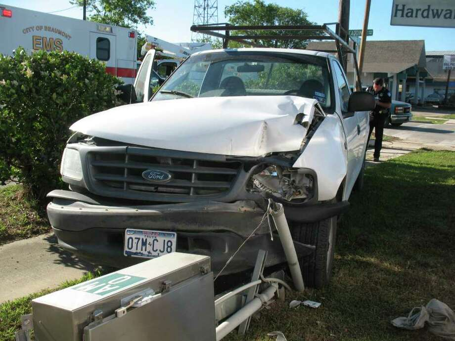A pickup truck crashed into a light box along MLK Parkway in Beaumont on Wednesday morning. Teresa Mioli/The Enterprise