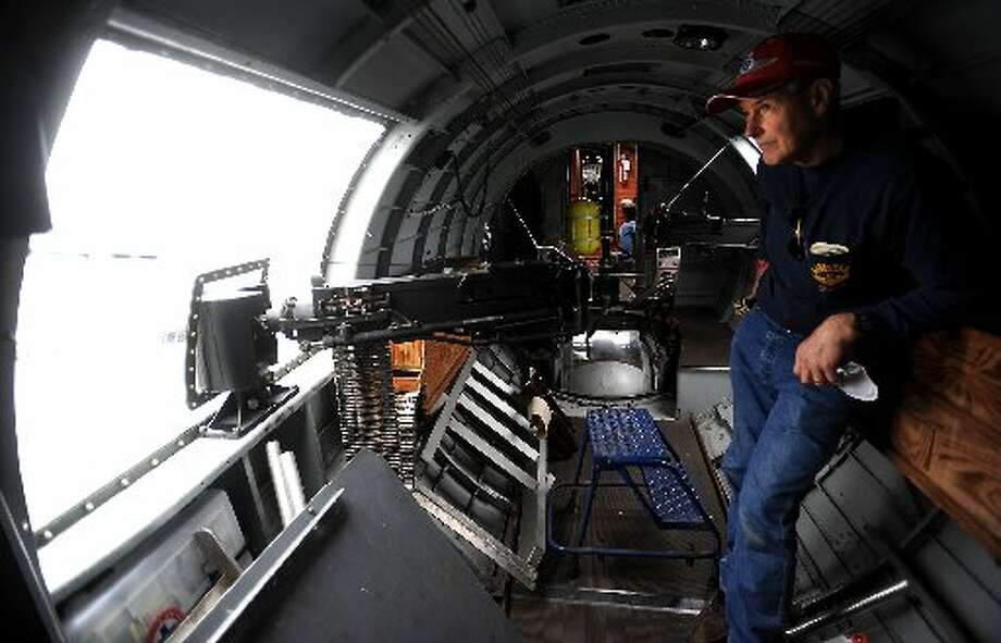 Crew Chief Harry Lawrence looks out the gun turret window of the 1945 B17 Bomber while waiting for the the rain to pass during the Jasper Air Show at the Jasper County Bell Field Airport in Jasper, Saturday. Tammy McKinley/ The Enterprise
