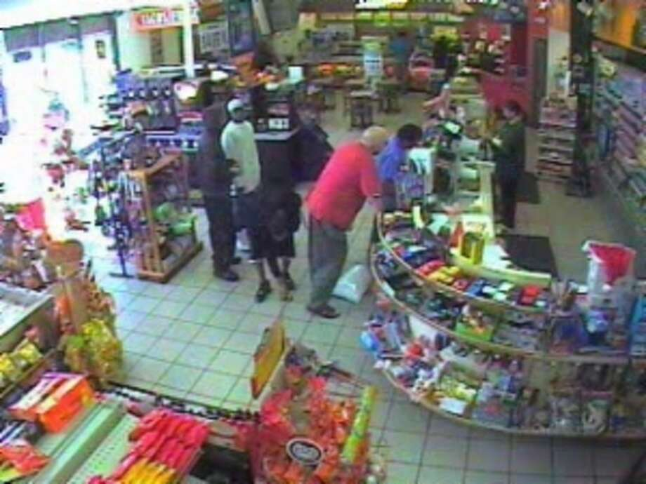 This video footage from the Speedy Stop at 7110 Eastex Freeway shows a man picking up money that the 71-year-old man in red dropped. Photo courtesy of the Beaumont Police Department.