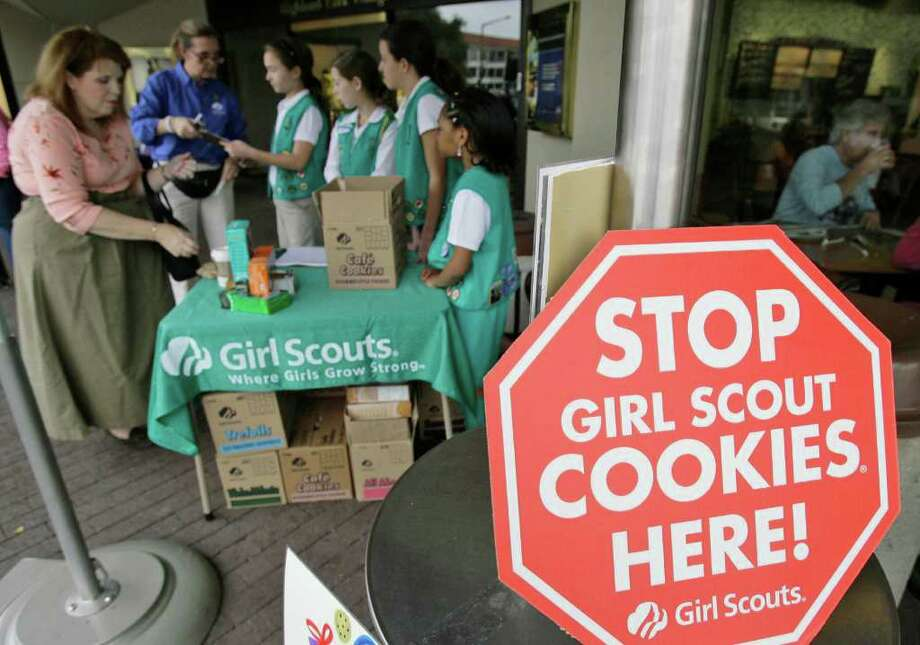 Girl Scout Cookies bought in Southeast Texas aren't effected by last week's news of bad tasting and smelling lemon-flavored cookies in some parts of the country. / AP2007