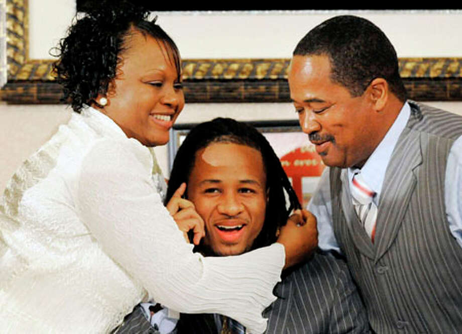 From the Sixth Street Community Church in Orange and surrounded by his mother Debbie, left, and father, Earl Thomas Sr., Earl  Thomas gets  the call from the Seattle Seahawks selecting him as the 14th overall pick in the NFL draft. Valentino Mauricio/The Enterprise / Beaumont