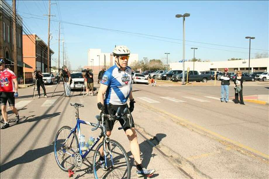 Gov. Rick Perry gets ready in Orange to ride the first leg of an 850-mile trek across Texas to raise money for Texas Rise Schools. Teresa Mioli/The Enterprise