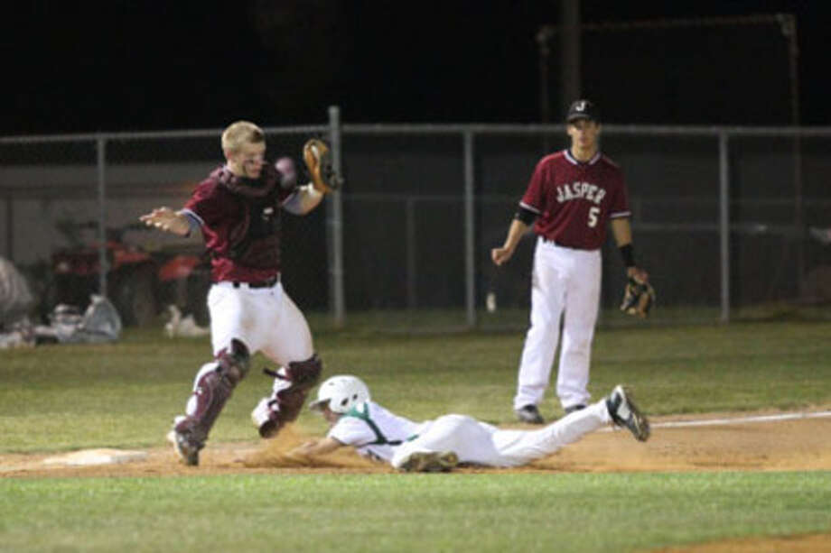 Jasper's Ty Parker tags out a Lufkin Central player during Tuesday's contest on the road.