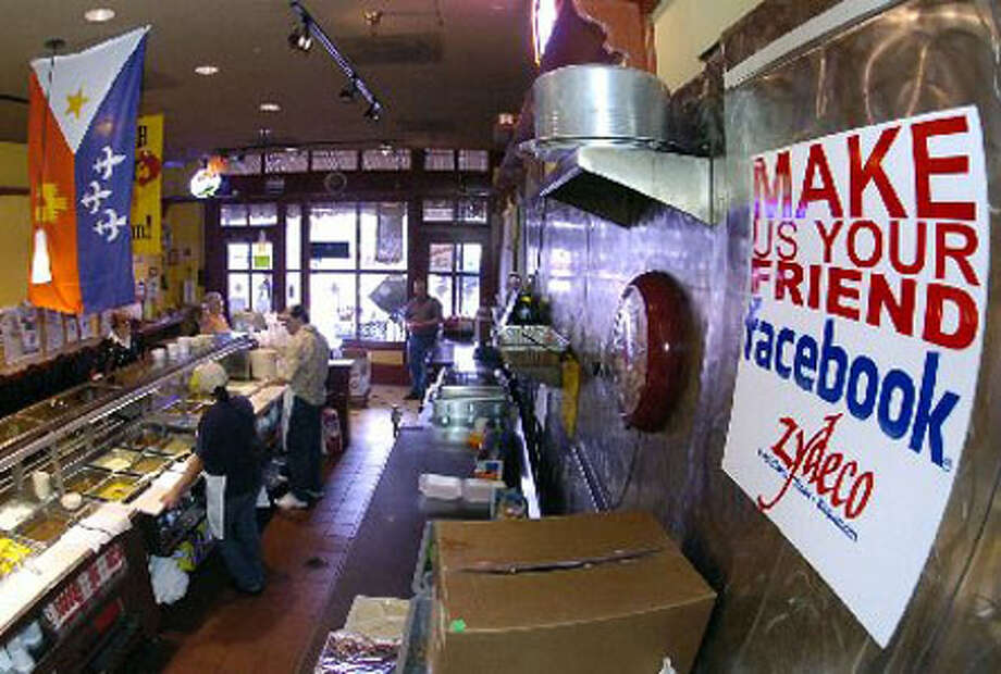 The sign to the right in the photo is above the serving counter at the Zydeco Louisiana Diner on Crockett Street.  Dave Ryan/The Enterprise