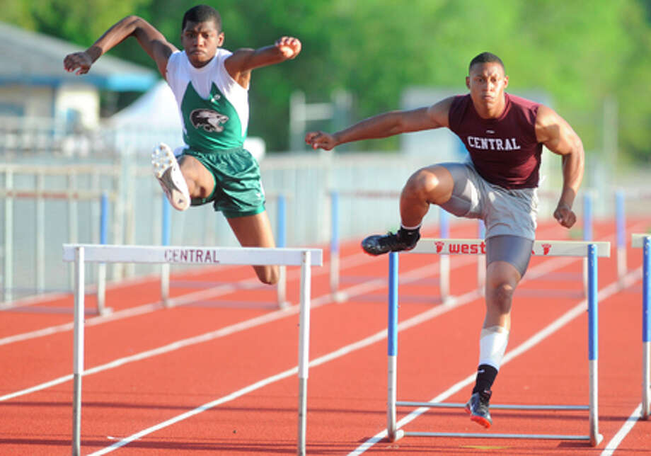 Central's Jacoby Hale, center, clears a hurdle on his way to victory in the 300 meter hurdles event at the District 20-4A Track and Field Championship at West Brook High School. Valentino Mauricio/The Enterprise / Beaumont