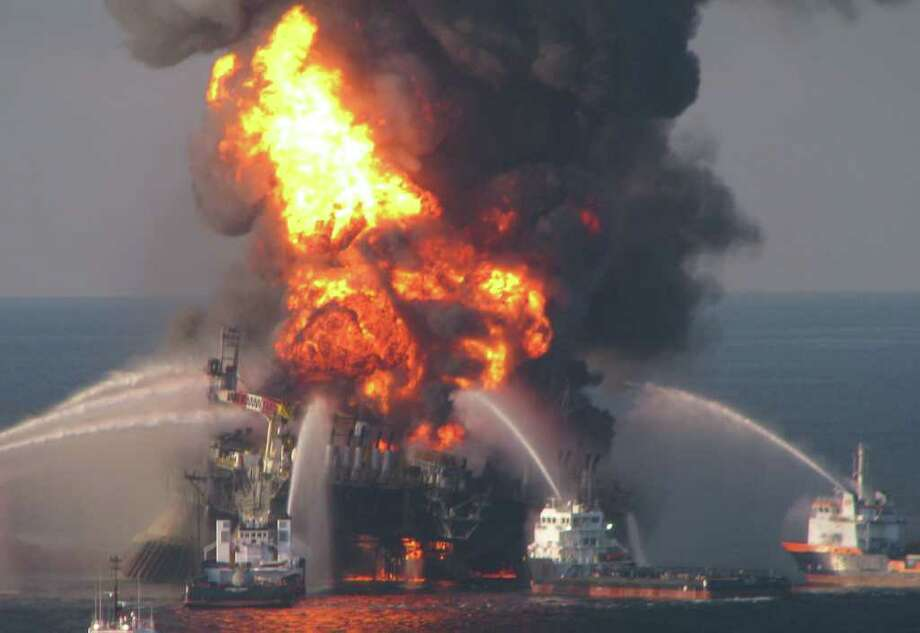 Fire boat response crews battle the blazing remnants of the off shore oil rig Deepwater Horizon. Multiple Coast Guard helicopters, planes and cutters responded to rescue the Deepwater Horizon's 126 person crew. / United States Coast Guard