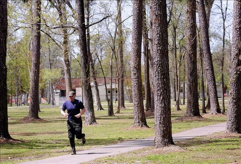 Joel Waldrop runs Tuesday through Wuthering Heights Park. Allergy season is here as pollen begins to fill the air and cause sinus problems for many. Guiseppe Barranco/The Enterprise