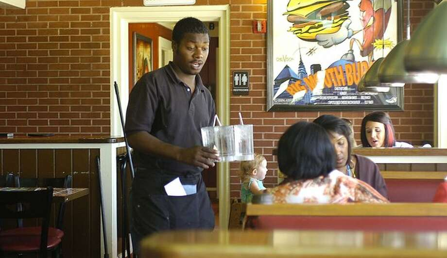 Cilton Williams, a waiter at Chili's Restaurant, who now lives in Beaumont, grew up near Beaumont California.  Dave Ryan/The Enterprise / Beaumont