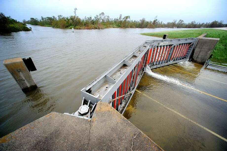 Hurricane Ike waters are held back by the levee gates along Farm Road 365 on September 13, 2008. Meeting new federal standards for levees could cost Jefferson County Drainage District 7 more than $500 million. Guiseppe Barranco/The Enterprise / Beaumont
