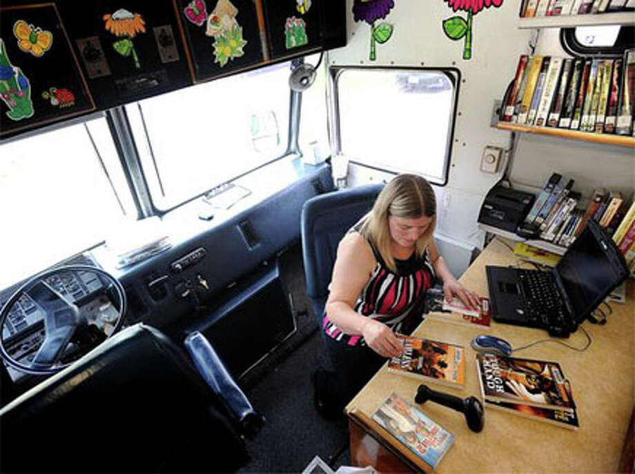 Using the Bookmobile as a vehicle of aid as well as education, Jefferson County Pct. 4 will be distributing food with books for kids during the summer months. Most rural areas do not receive the summer food programs that urban children are privileged to. Guiseppe Barranco/The Enterprise