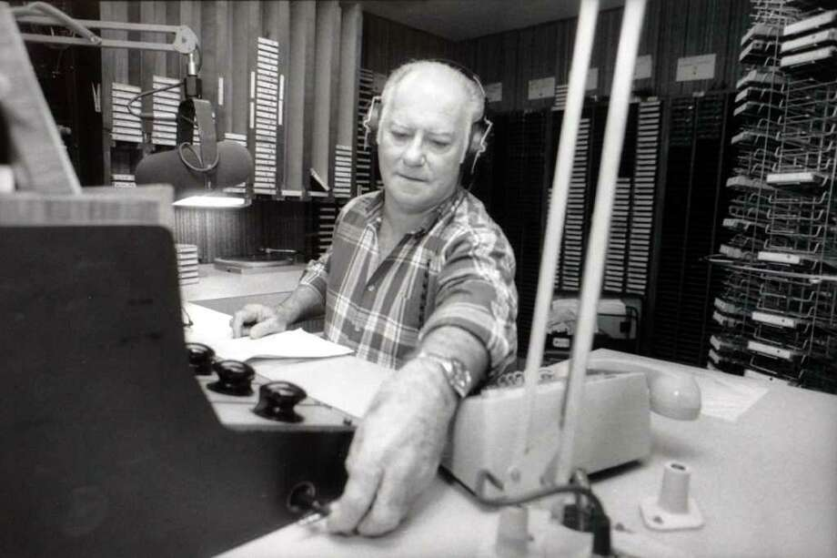 "John ""Tee Bruce"" Broussard does his radio show on KLVI in 1990. Enterprise file photo / Beaumont"