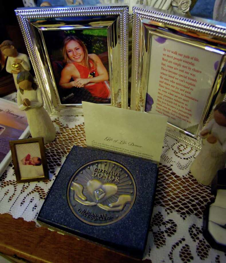 Kathy Hernandez lost her 19 year old daughter Casey Hastings, to a car accident in 2007. Seven of her daughter's organs were donated to various recipients after her death. A Gift of Life Donor Medal, sits next to a picture of Casey in the dining room of Hernandez's home. Dave Ryan/The Enterprise / Beaumont