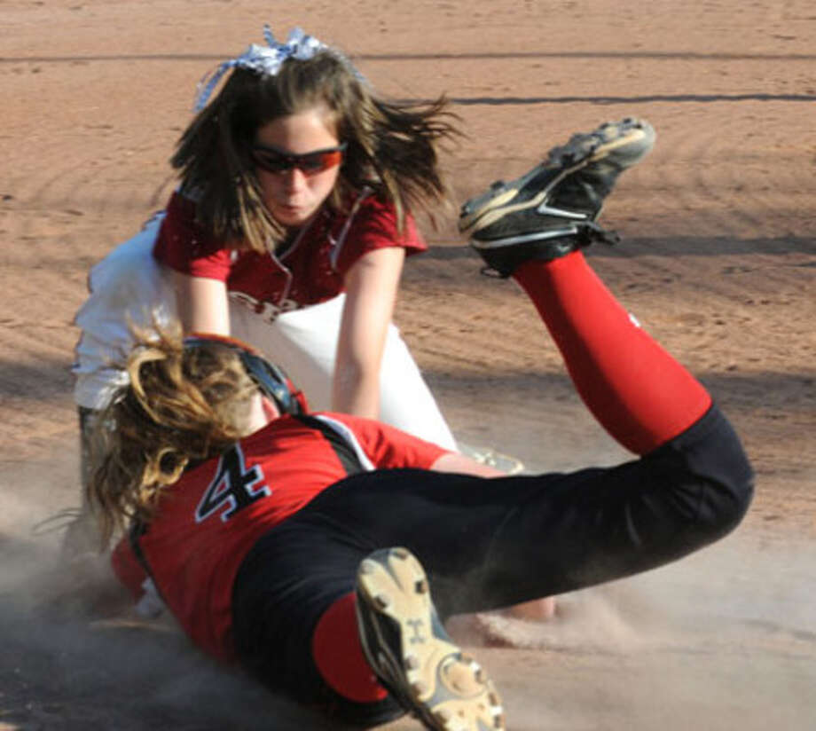 Kaylie Dickerson tags out the runner at third base, ending Huntington's chance for attitional runs.