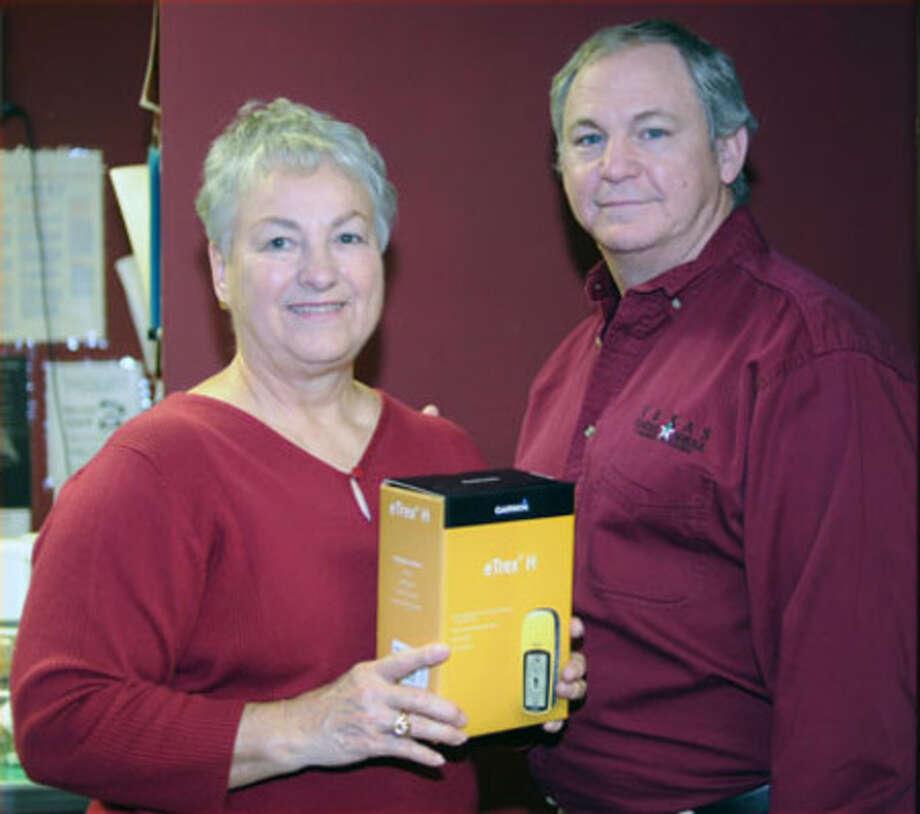 Master Gardener Margie Saulsbury was presented a Garmon GPS unit from The Ladybird Johnson Wildflower Center by Texas Forest Service   Specialist Mike Murphrey, Friday, Feb. 12.