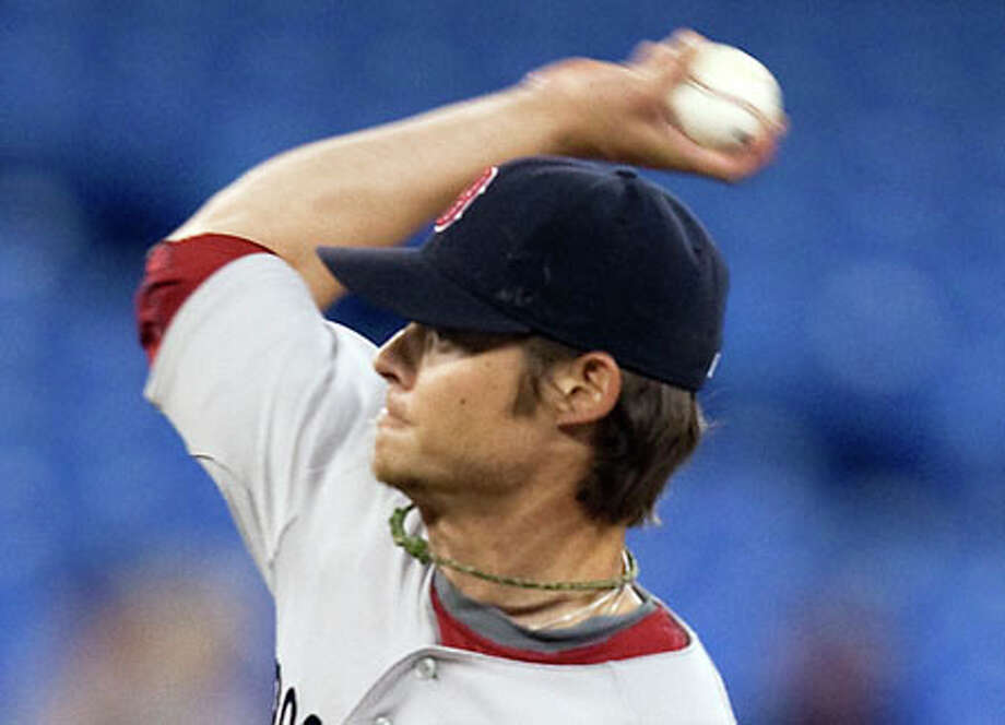 Boston Red Sox starting pitcher Clay Buchholz works against the Toronto Blue Jays during the second inning of a baseball game against the Toronto Blue Jays in Toronto on Tuesday. (AP Photo/The Canadian Press, Frank Gunn) / The Canadian Press