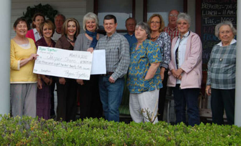 Members of the Greater Jasper Share Program accepts a check donation from Thyme Together.